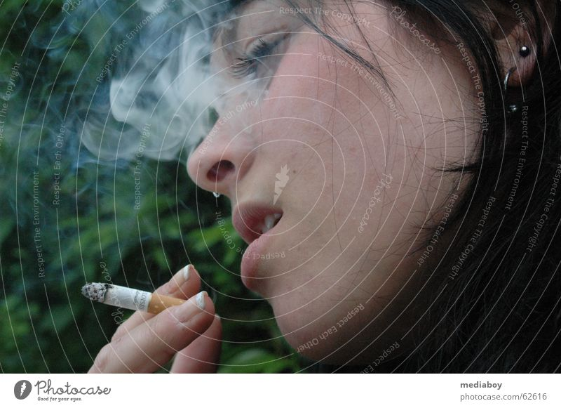 nicotine Smoking Smoke Breathe Think Cigarette Dependence Nicotine Colour photo Exterior shot Day Closed eyes Young woman Youth (Young adults) 18 - 30 years