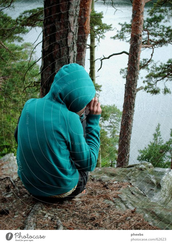 a small photographing turquoise hoodie goblin Forest Green Turquoise Hooded (clothing) Lake Photographer Take a photo Pants Leaf Brown Tree trunk Sunset Small