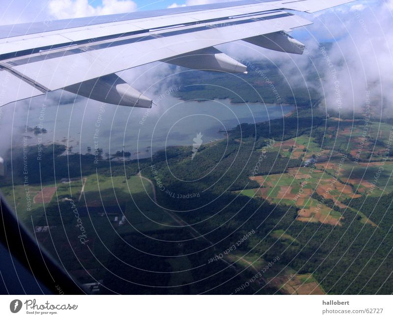 Mauritius from above Airplane Clouds Above the clouds Wing Engines Aviation
