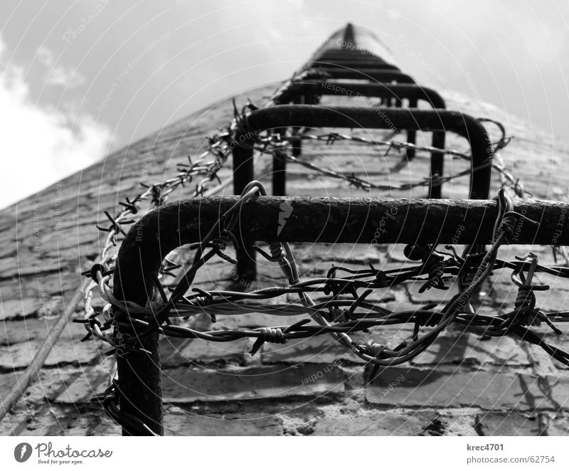 into the sky Sky Brick Barbed wire Go up Derelict Train station Black & white photo Chimney Ladder Upward prevent