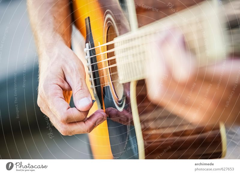 man playing a guitar Playing Music Hand Concert Guitar acousting guitar pick strings music notes people Live country musician country and western Practice