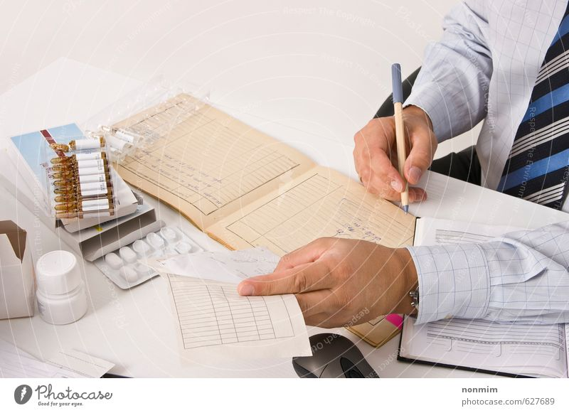 Clinical research Human being Man Hand Adults Healthy Work and employment Health care Office Paper Profession Write Shirt Document Testing & Control Intoxicant Medication
