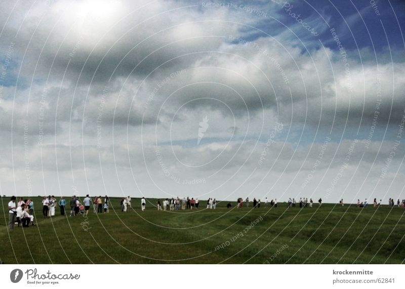 stones look Clouds Meadow Human being Accumulation Looking Tourist England Stonehenge Megalith monument Circle Mystic Mysterious Attraction Dark Storm clouds