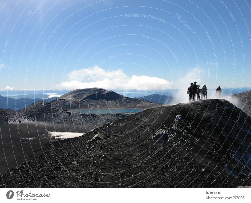 Tongariro Colour photo Exterior shot Day Silhouette Long shot Vacation & Travel Freedom Hiking Climbing Mountaineering Human being 6 Group Landscape Earth Water