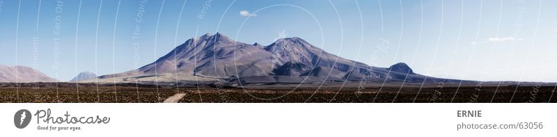 Sky Vacation & Travel Clouds Cold Grass Mountain Stone Large Rock Tall Thin Dry Panorama (Format) Volcano Chile South America