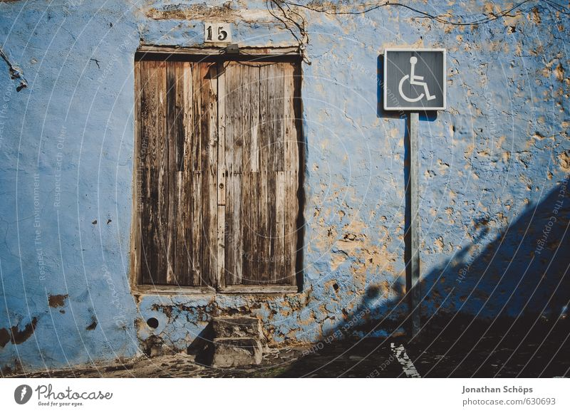 Blue Old House (Residential Structure) Window Wall (building) Wall (barrier) Brown Door Signs and labeling Signage Simple Spain Village Clue Flake off