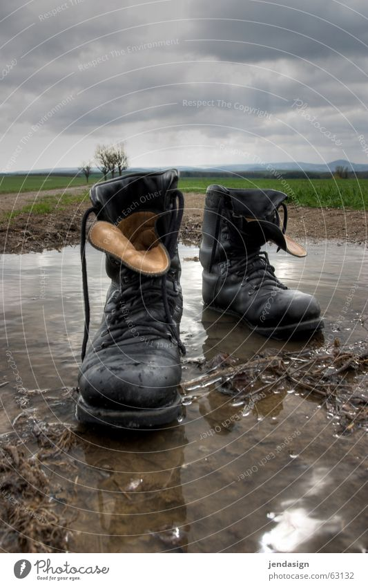Boots off! Puddle Army Pacifist Shoelace Shoe sole In step Rain militarism Right Force antig violence Stride