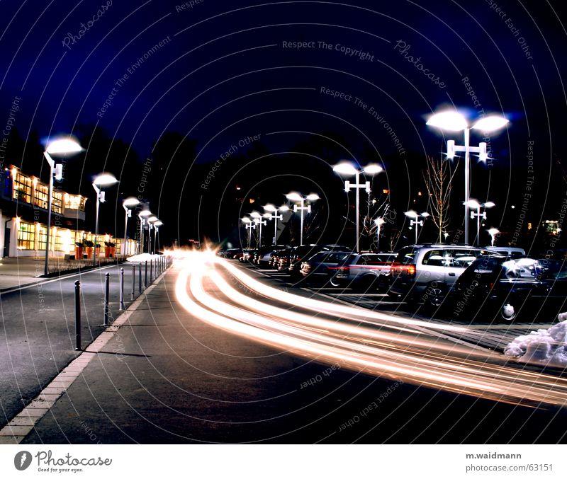 Where's my parking space? Parking lot Lamp Transport Driving Long exposure Night shot Exterior shot Dark Car vehicles Movement Floodlight motion Light