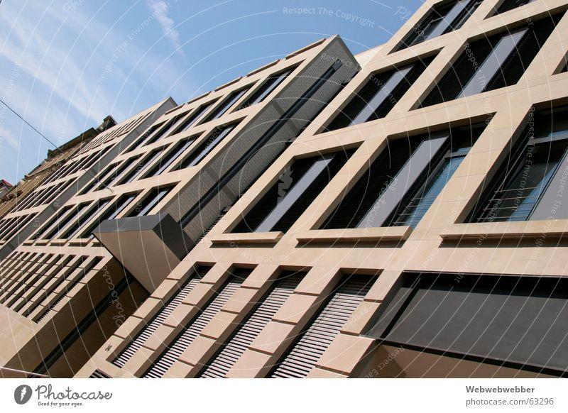Publishing building in Stuttgart Facade Exterior shot facade building building windows topple topple office city work business beige