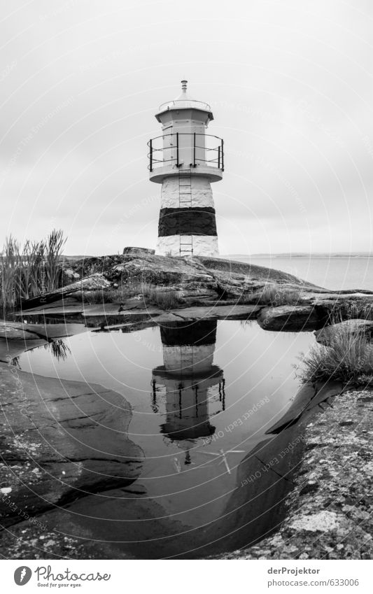 Lighthouse b/w in Sweden - Archipelago Deserted Architecture Tourist Attraction Landmark Monument Navigation Old Esthetic Authentic Cliche Lamp Skerry