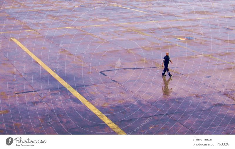 walking after the rain Men step alone reflection.