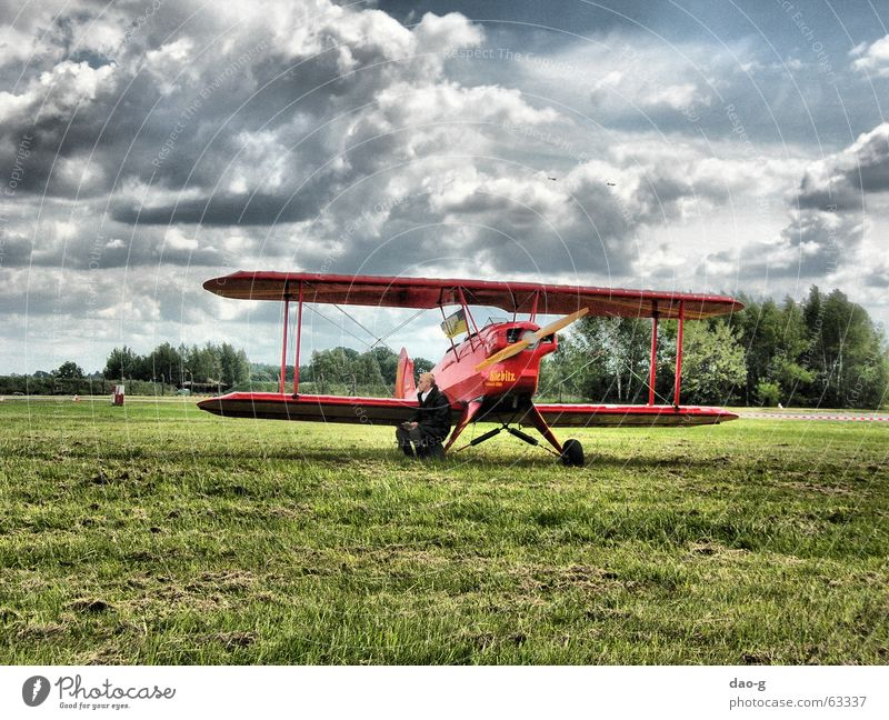 He and his plane. Airplane Pilot Red Clouds Meadow Double-decker bus Old Flying Sky