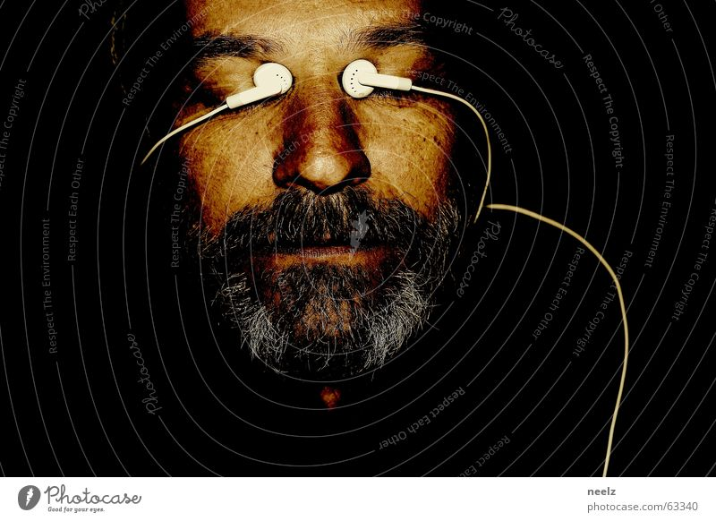 interface Portrait photograph Headphones Dark Listening White Black Facial hair Gray Face Eyes Looking Cable MP3 player
