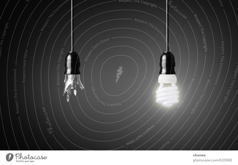 One broken and one glowing energy saving light bulb Design Lamp Technology Energy industry Glass Bright Green Black White Idea Creativity background break