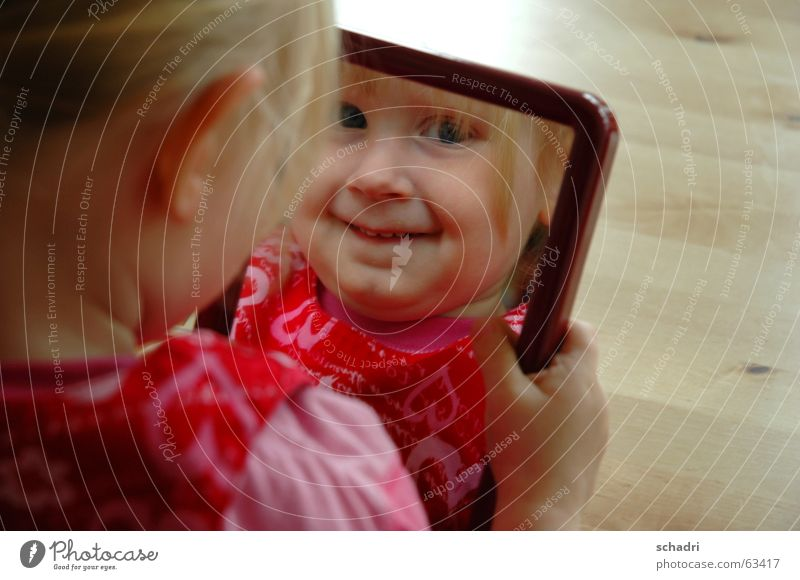 Do you see me? Child Girl Mirror Grinning Sweet Portrait photograph Red Pink Laughter