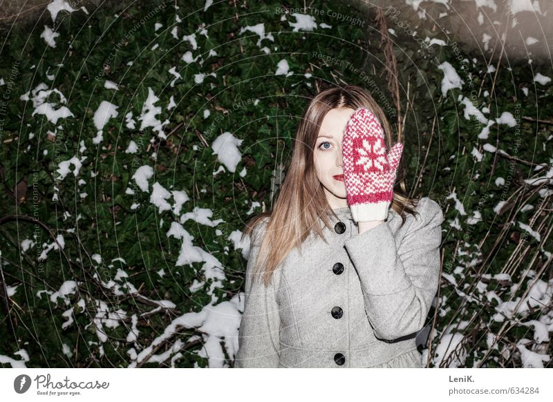 hide and seek Winter Snow Young woman Youth (Young adults) Hand Gloves Discover Smiling Looking Brash Free Happiness Curiosity Green Pink Freedom