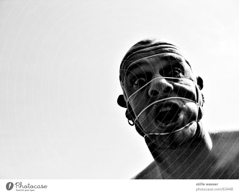 captive Whimsical Rubber Bald or shaved head Looking Designer stubble Bound Trashy Elastic band Earring Face ahhh Wrinkles tied Black & white photo and and and