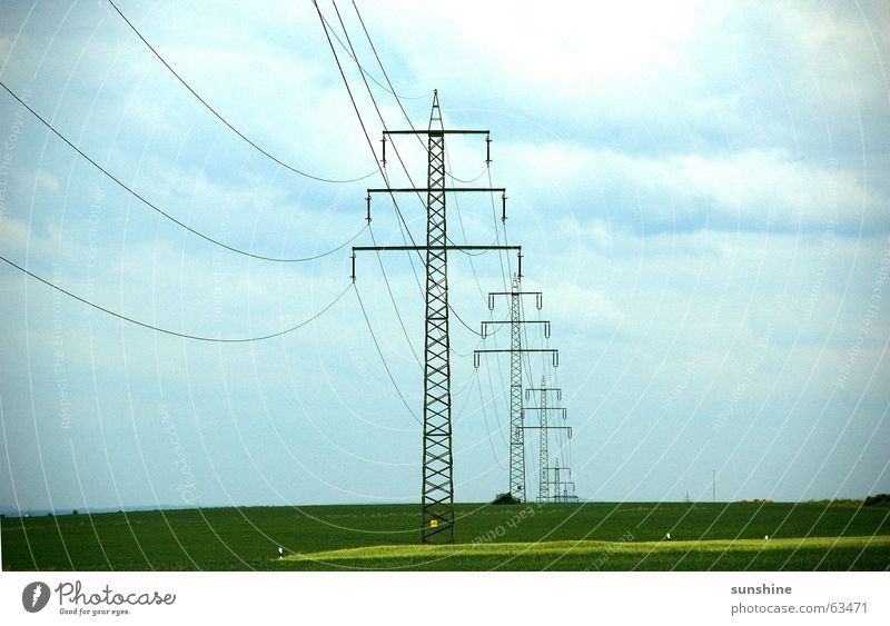 under current Electricity Electricity pylon Clouds Field Nature Sky Cable Metal Deep
