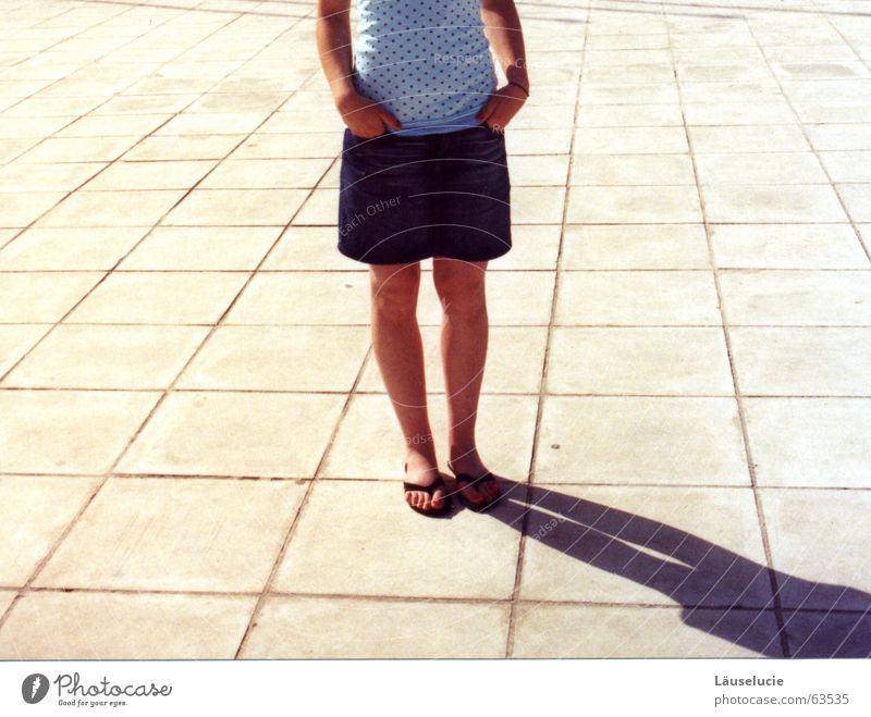 Summer Adults Legs Wait Places Stand Floor covering Individual Section of image Partially visible Patient Summery Paving tiles Headless Mini skirt Flip-flops