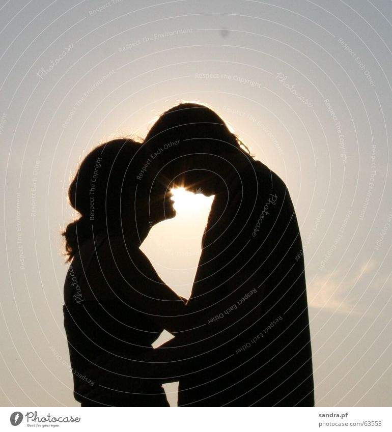 Woman Man Sun Love Couple In pairs Kissing Sunset Embrace