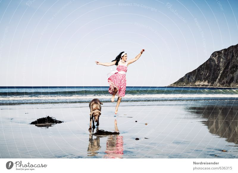 Dancing woman with dog on the beach Lifestyle Joy Happy Fitness Well-being Contentment Vacation & Travel Summer Summer vacation Sun Beach Ocean Feminine Woman
