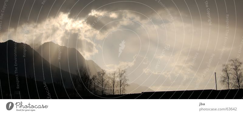 Sky Tree Sun Clouds Dark Mountain Bright Switzerland Hill Radiation To break (something) Breach Reanimation Wisp of cloud Suppose