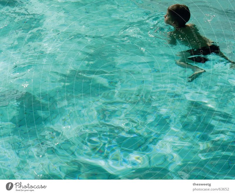 Child Blue Water Boy (child) Swimming & Bathing Swimming pool Individual Turquoise Copy Space Surface of water Open-air swimming pool Water reflection