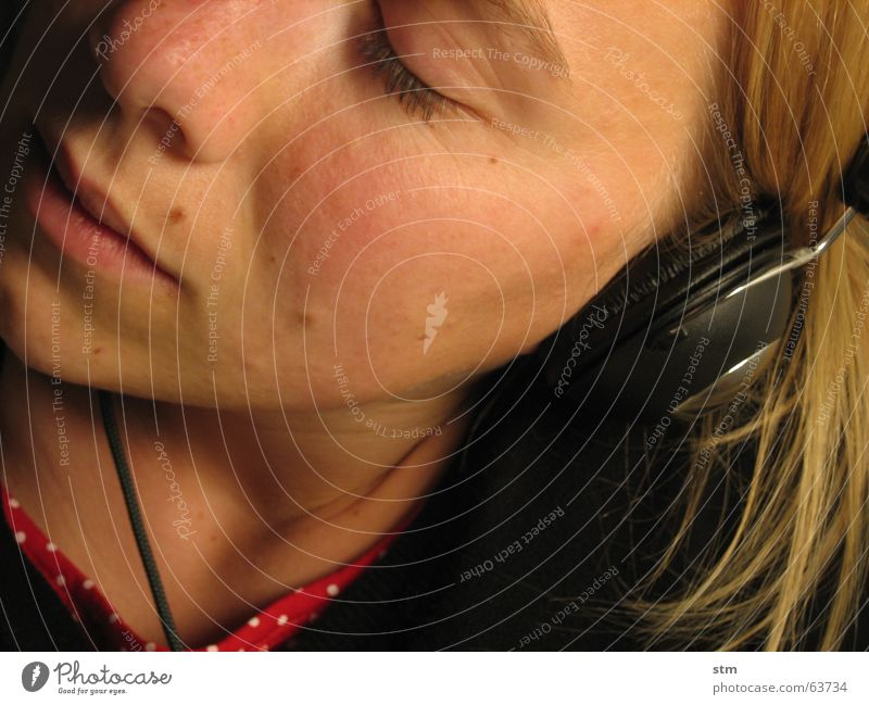 Half portrait of a woman with headphones Listening Dream Headphones Freckles Sense of hearing Stereo Emotions Sound Hi-fi Headset Music Nose Mouth Technology