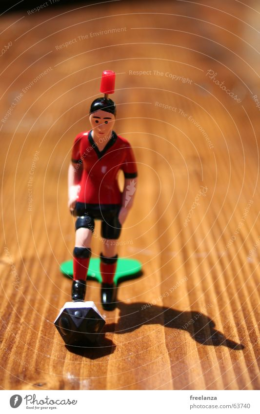 The ball has corners... Red Black Brown Wood White Things Obscure Shadow Sports Table soccer Piece 1 Bump Front view Shallow depth of field Wood grain