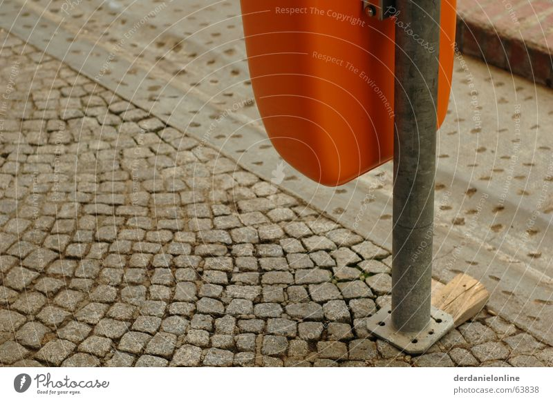 street furniture Gray Trash container Wastepaper basket Cobblestones Old Dirty Orange wooden wedge Pole