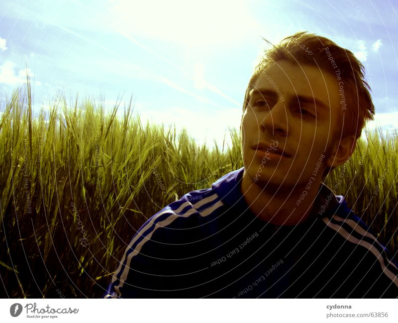 I'm going to take a break... Man Jacket Break Hooded jacket Portrait photograph Fatigue Grass Field Calm Think Summer Emotions Green Physics Concentrate