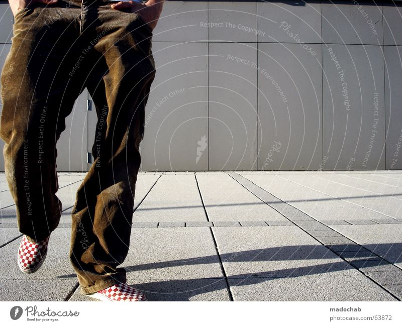 Human being Man Youth (Young adults) Vacation & Travel Loneliness Relaxation Wall (building) Architecture Gray Movement Wall (barrier) Legs Brown Leisure and hobbies Going Walking