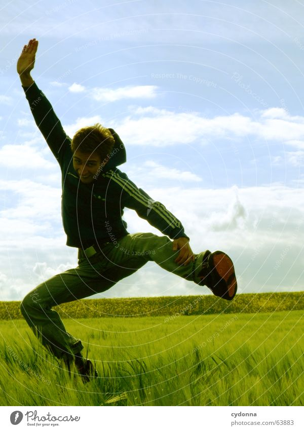 Human being Sky Man Nature Youth (Young adults) Sun Summer Joy Landscape Playing Emotions Freedom Grass Jump Power Field