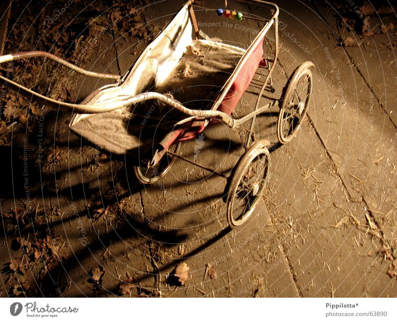 child's dream Happiness Grief Forget Carriage Dream Playing Puppet player Baby carriage Attic Time Past doll car Old dusty Sadness Doll
