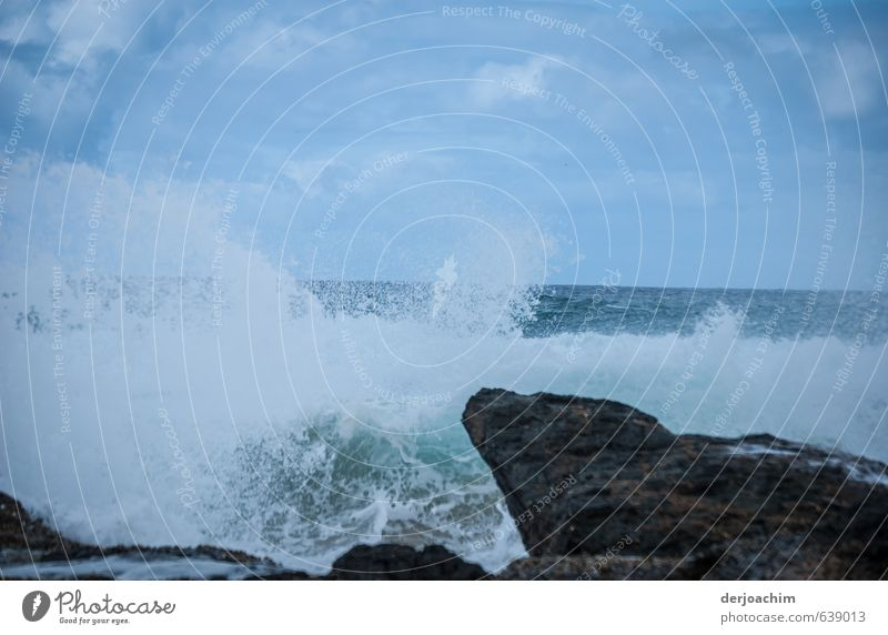 The waves leap up the rocks. Adventure Ocean Waves Aquatics Environment Nature Elements Water Sky Summer Gale Rock Stone Observe Looking Swimming & Bathing