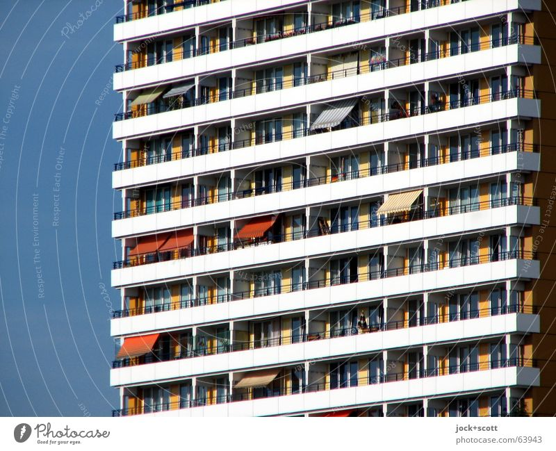 balconies, place in the sun Cloudless sky Summer Marzahn Architecture Town house (City: Block of flats) Facade Balcony Window Sun blind Concrete Stripe