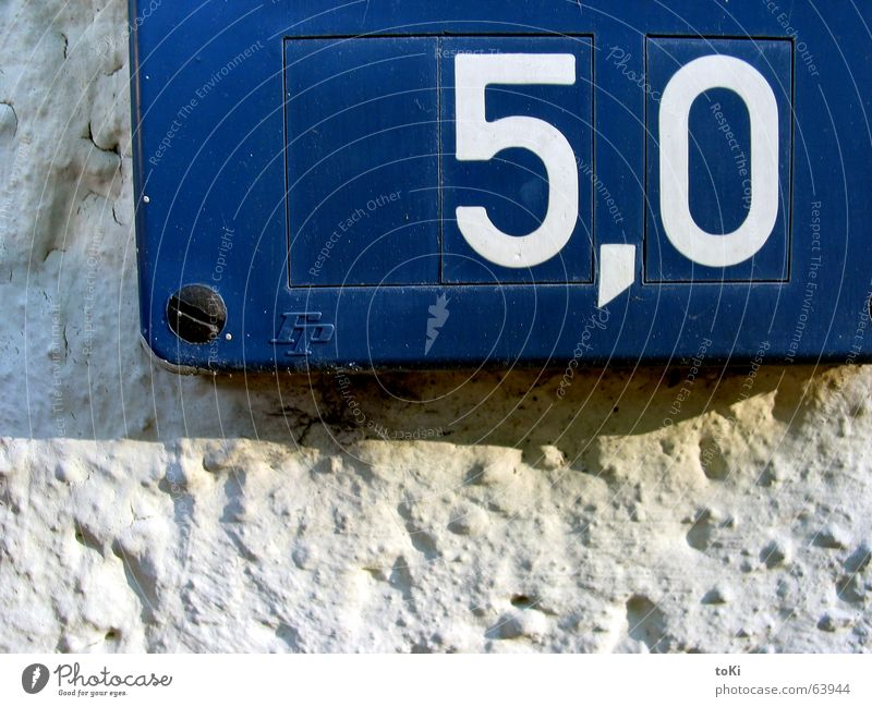 Water Blue Wall (building) Wall (barrier) Empty Information Digits and numbers 5 Signage Display Screw Comma