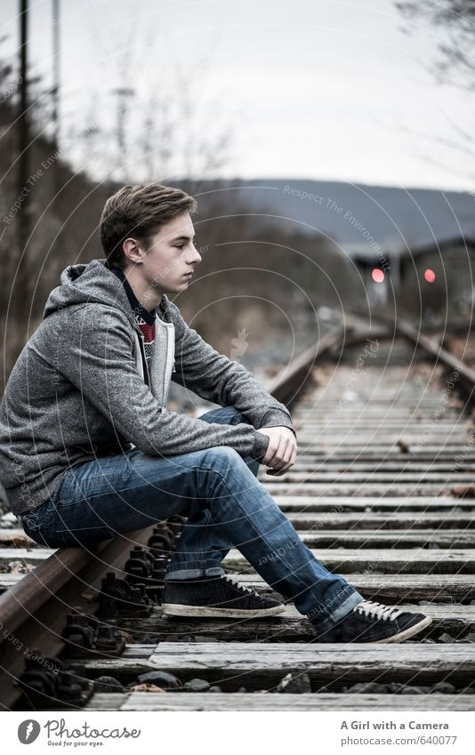 Human being Child Youth (Young adults) Beautiful Young man Boy (child) Think Masculine Body Sit 13 - 18 years Wait Railroad Cool (slang) Uniqueness Jeans