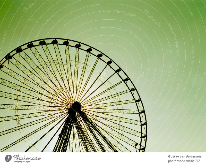 ... wheel Ferris wheel Fairs & Carnivals Back-light Round Rotate Giddy Iron Colossus Framework Black Green Yellow Shooting match Construction Tall Scaffold Sun