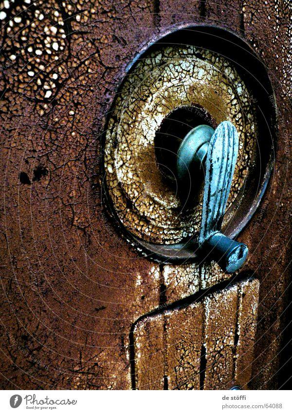 Old Brown Metal Dirty Round Broken Rust Door handle Dappled Petrol station Crank