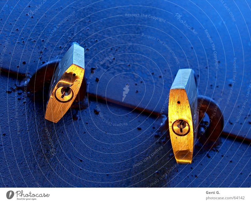 two golden padlocks with keyhole on blue surface Safety Close Closed Padlock Keyhole 2 Together Light Moody Gold Blue Twilight Reduplication In pairs