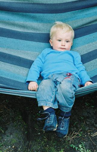 dreaming boy Child Hammock Stripe Dream Blonde Small Sleep Dreamily Relaxation Boy (child) Easygoing Candy Blue childhood Fatigue blue eyes Multicoloured Jeans