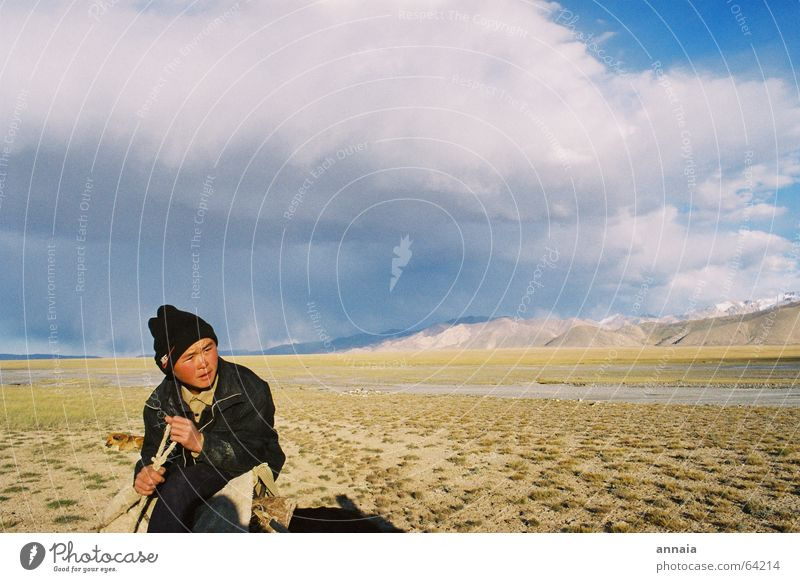 Sky Vacation & Travel Clouds Calm Far-off places Mountain Grass Boy (child) Adventure Rope Cap Russia Steppe Equestrian sports Nike Kyrgyzstan