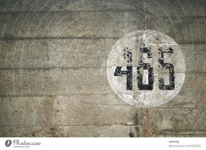 465 Round Wall (barrier) Parking garage Wall (building) Digits and numbers White Black Gray Transience Ravages of time four hundred and sixty-five Circle