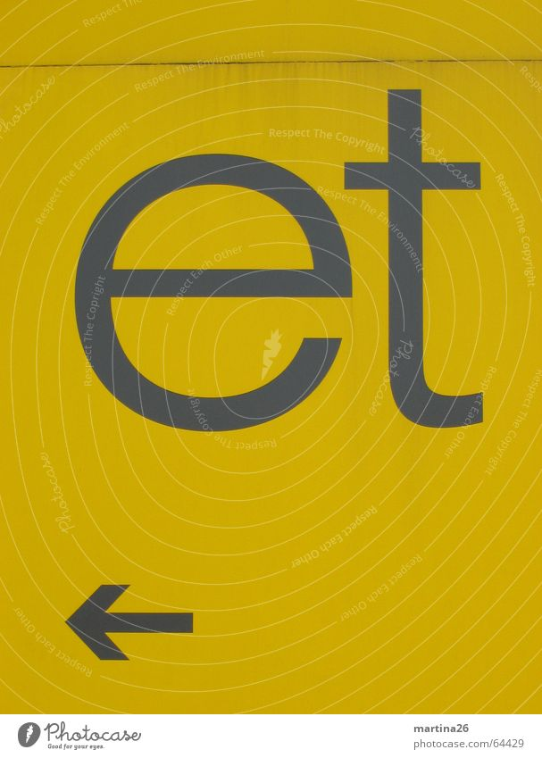 Yellow Wall (building) Wall (barrier) 2 Signs and labeling Modern Characters Letters (alphabet) Clarity Arrow Typography Direction Word Left Road marking Tin
