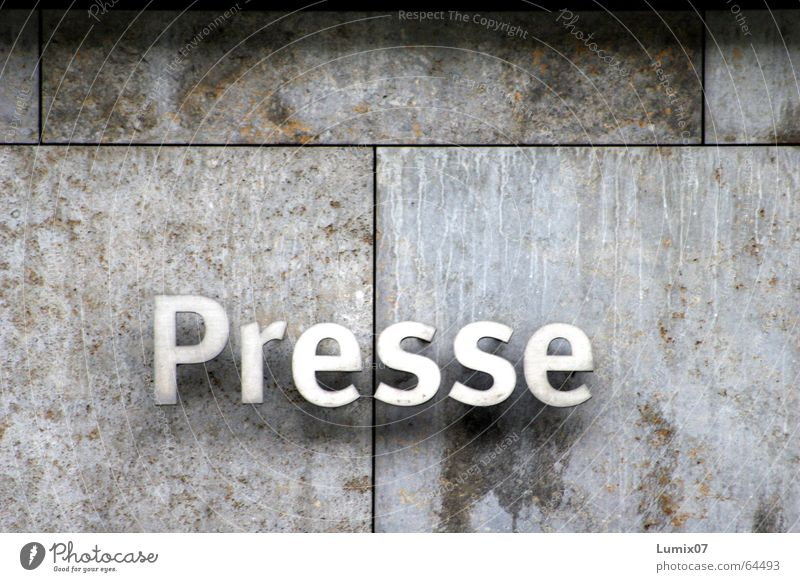 Press Colour photo Exterior shot Print media Stone Metal Characters Purity Stone wall Letters (alphabet)