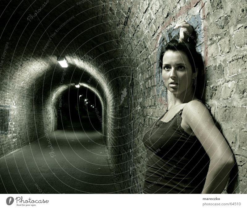 At the end of tunnel II Tunnel Stagnating Stand Dark Watchfulness Woman Light Admiration Tunnel vision Loneliness Night Think End Graffiti ponder Empty Looking