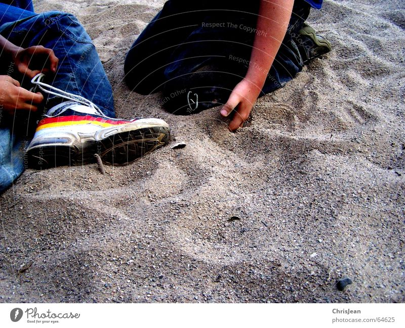 Human being Hand Sand 2 Footwear Sit Jeans Pants Knot Bond Shoelace Grain of sand Shoe sole Football boots