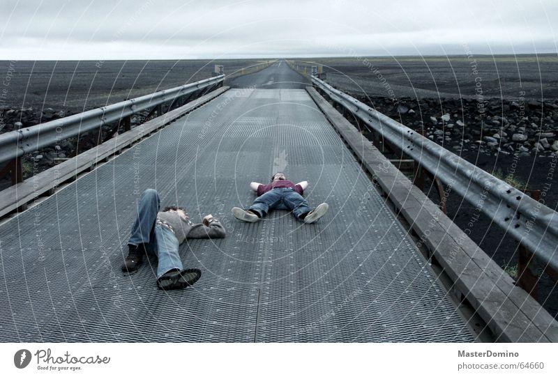 Human being Man Sky Clouds Far-off places Street Dark Relaxation Freedom Gray Stone Rain Weather Horizon Sleep Bridge