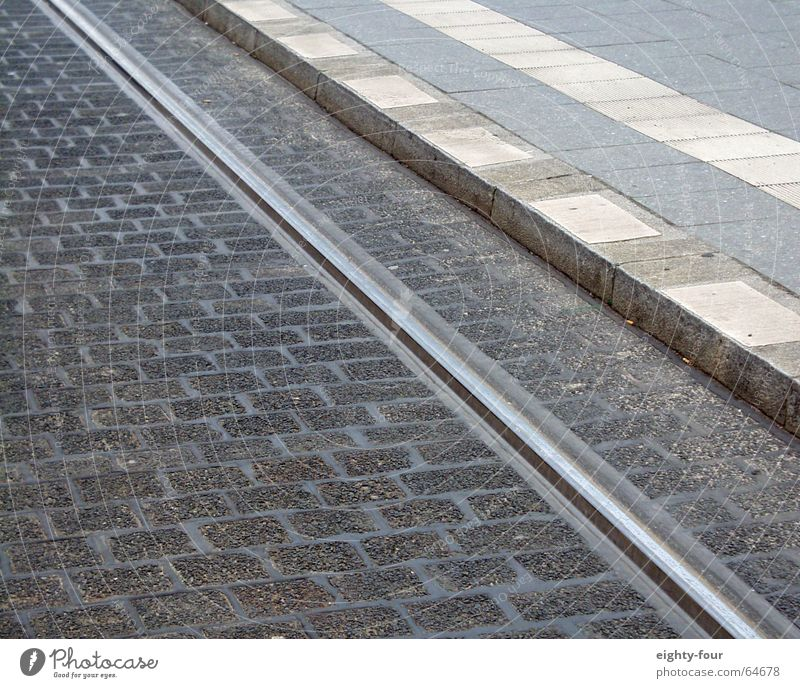track_study_03 Asphalt Concrete Railroad tracks Tram Driving Transport Gray Curbside Street Cobblestones eighty-four Lane markings
